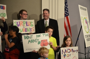 MSBA President Kevin Donovan stands next to what education organizations are fighting for --- the students of Minnesota.
