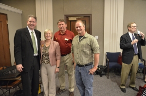 MSBA President talked with Forest Lake Area School Board members (from left) Gail Theisen, Dan Kieger and Rob Rapheal following Monday's press conference.